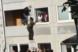 Populares unem-se para salvar pessoas de prédio em chamas [vídeo]
